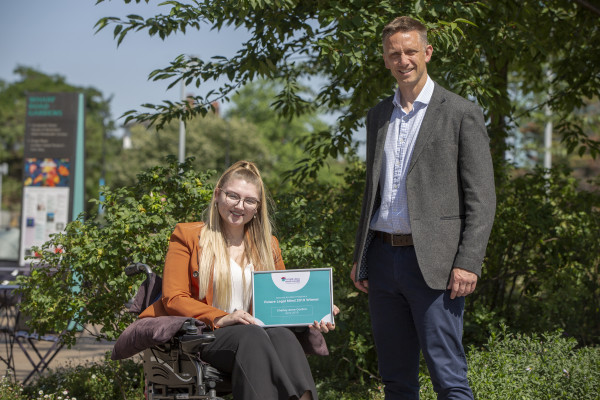 Our Future Legal Mind 2019 winner Charley-Anne Gordon with competition judge Adam Nabozny